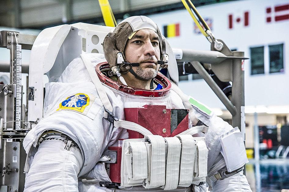 ESA_astronaut_Luca_Parmitano_suiting_up_for_EVA_training_fullwidth