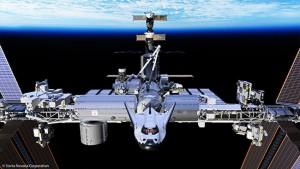 Un rendering del Dream Chaser agganciato all'ISS. (C) SNC