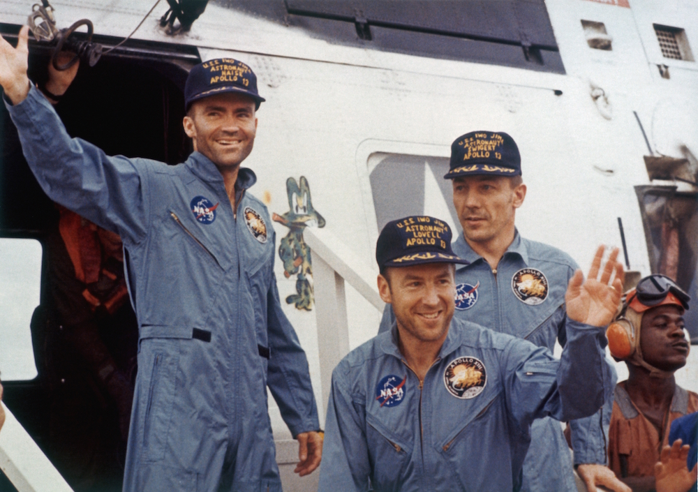 The safe return of the Apollo 13 astronauts after their lunar landing mission encountered technical difficulties, 17th April 1970. From left to right, Lunar Module pilot Fred W. Haise, Mission Commander James A. Lovell and Command Module pilot John L. Swigert (1931 - 1982). (Photo by Space Frontiers/Getty Images)