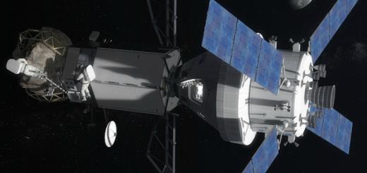 Un astronauta ispeziona il frammento di asteroide dopo l'attracco di Orion alla sonda robotica. (fonte: NASA)